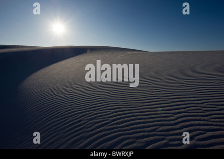 Sunburst  and sand pattern in the white gypsum sand dunes of White Sands National Monument in Alamogordo, New Mexico, - Stock Photo