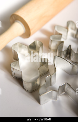 Christmas cookie cutters and rolling pin, close up. - Stock Photo
