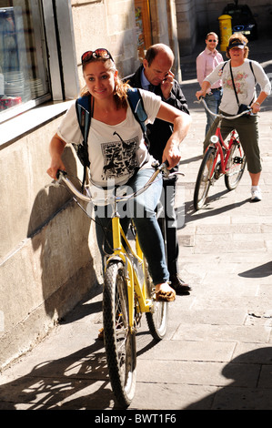 Young girl riding bicycle in the gothic quarter of Barcelona Spain - Stock Photo