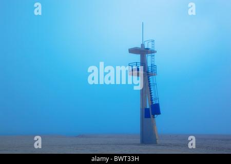 Lifeguard tower on Playamar beach in off-season on foggy day. Torremolinos, Malaga Province, Costa del Sol, Spain. - Stock Photo