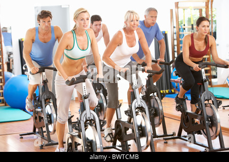 Group, People In Spinning Class In Gym - Stock Photo