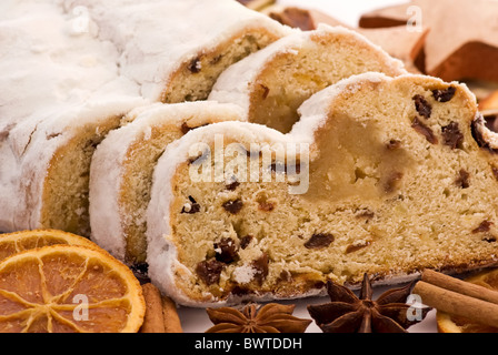 Marzipan stollen with Christmas decoration as closeup on white background - Stock Photo