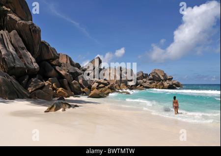 Woman on the beach of Grand Anse, La Digue, Seychelles - Stock Photo