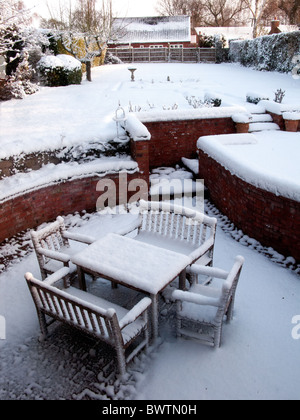 Snow covering outdoor table and chairs on patio during Winter, London, England - Stock Photo