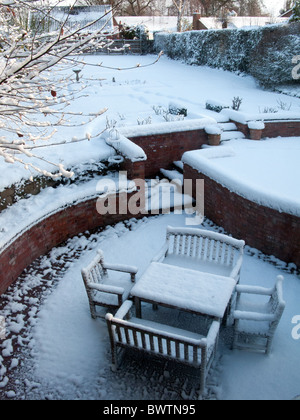 Snow covering outdoor table and chairs on patio during Winter, London, England. - Stock Photo