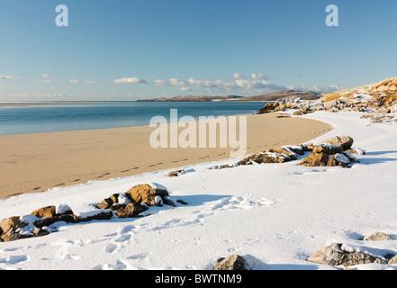 Snow on the beach at Luskentyre on the isle of Harris, Scotland - Stock Photo