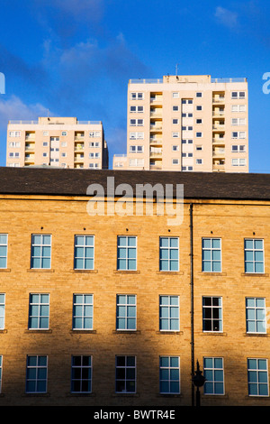 Bowling Mill at Dean Clough Mills with Modern Flats behind Halifax West Yorkshire England - Stock Photo