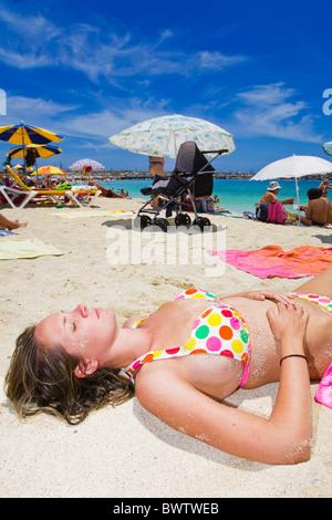 Sunbather on Amadores Beach in Gran Canaria - Stock Photo