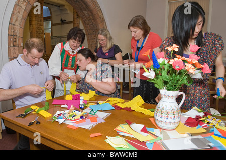 Craft workshop on paper-cuttings and flowers making by folk artist Apolonia Nowak from Kurpie Region of Poland - Stock Photo
