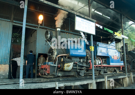 Old steam locomotives with a British origin still function on the Darjeeling-based Himalayan railway - Stock Photo