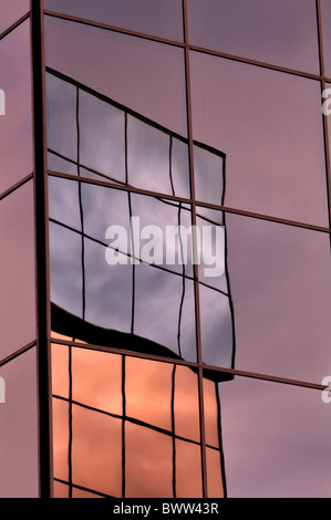 Reflection of buildings in mirrored glass - Stock Photo