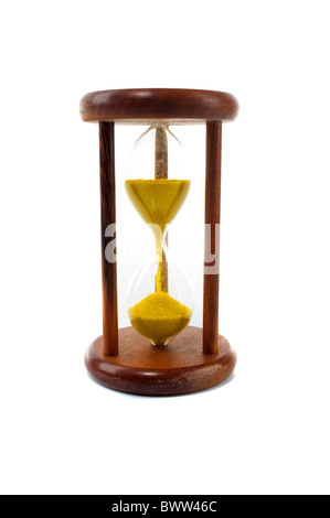 Vintage hourglass with yellow sand . - Stock Photo