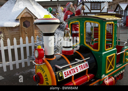 Santa's Children's Train Engine and Railway Buildings in Christmas Grotto with rides in Chester, 2010, UK - Stock Photo
