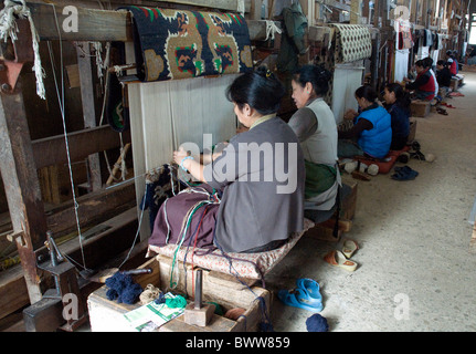 Using mainly sheep's wool, the Tibetan Refugee Centre in Darjeeling provides paid work for Tibetans who fled China's - Stock Photo
