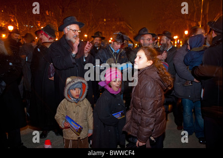 Paris, France, Jewish Families Celebrating Annual Religious Holiday, Hanukkah, Candle Lighting Ceremony, Night - Stock Photo