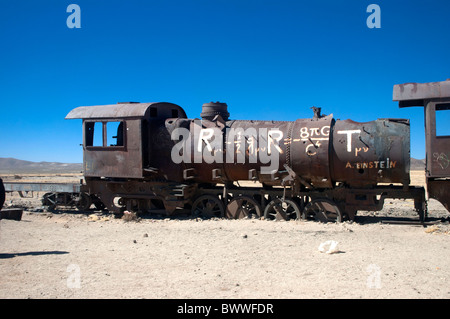 An old steam engine at the Cementterio de Trenes, train cemetery of trains, at Uyuni, Bolivia. - Stock Photo