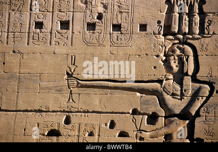 Detail of a carved stone wall at the ancient temple for Isis on the island of Philae on the Nile river, Egypt. - Stock Photo