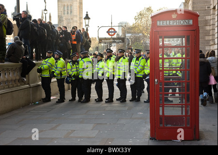 A line of Metropolitan Police Officers kettling at a demonstration in London. - Stock Photo