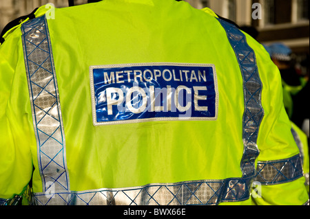 Metropolitan Police Officer wearing a hi-viz jacket in London. - Stock Photo
