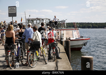 Waren an der Müritz Wait with the bike on the ship - Stock Photo