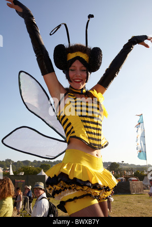 Stiltwalker Honey Bee Glastonbury Festival  Somerset UK Europe - Stock Photo