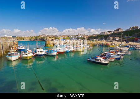 Small fishing boats in Newquay harbour Cornwall England GB UK EU Europe - Stock Photo