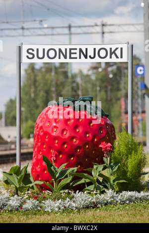 Strawberry symbol and sign of city of Suonenjoki , where strawberry cultivation is a major source of income at summertime - Stock Photo