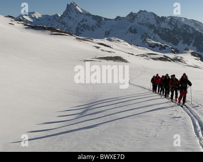 A Eagle ski club group heading to the Col de Cheilon above the Cabane des Dix, Switzerland - Stock Photo