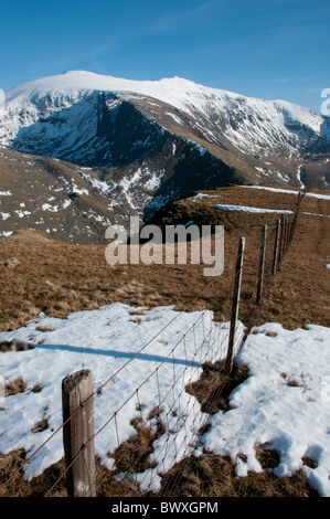 The Snowdon massif in spring from Moel Cynghorion - Stock Photo