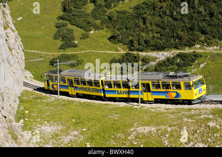 Downhill going train of the Wendelstein cog railroad shortly after the summit station, Bavarian alps, Germany - Stock Photo