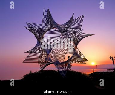 sculpture Switzerland Europe modern star-shaped metal sundown lake sea Lausanne Olympia museum - Stock Photo