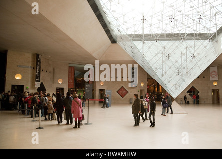 People at the entrance to the Louvre Art Gallery, Paris France - Stock Photo