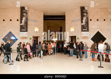 People queuing at the entrance to the Louvre Art Gallery, Paris France - Stock Photo
