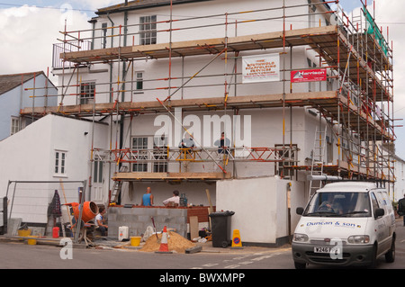Scaffolding and building work being done on a large house in Southwold , Suffolk , England , Great Britain , Uk - Stock Photo