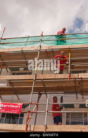 Roofers at work on a large house in Southwold , Suffolk , England , Great Britain , Uk - Stock Photo