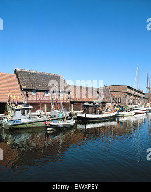 Germany Europe Mecklenburg Western Pomerania Wismar old harbour port brick buildings fishing boats - Stock Photo