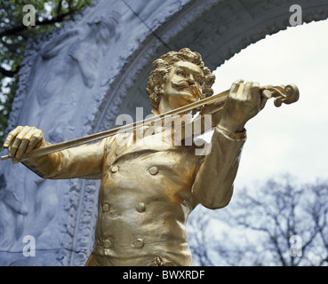 golden Johann Strauss monument classical music composer Austria Europe sculpture town park landmark Vienna - Stock Photo