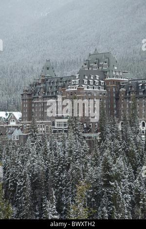Banff Springs Hotel in late winter, Banff, Banff National Park, Canadian Rockies, Alberta, Canada - Stock Photo