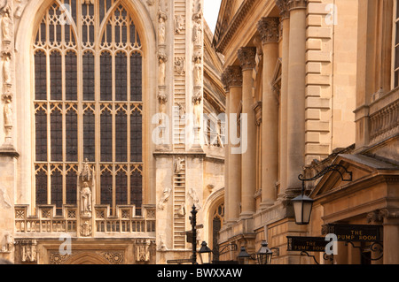 Bath Abbey ahead with the 'Pump room' entrance to the right. Bath. England - Stock Photo
