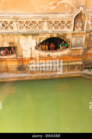 Kings Bath, Roman Baths with children looking out at the water, BATH, England UK - Stock Photo