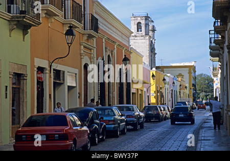 Colorful building facades and parked cars in a street, Campeche town, Mexico. - Stock Photo