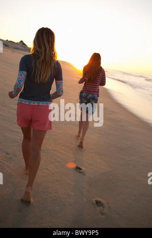 Women Running on Beach, Baja California Sur, Mexico - Stock Photo