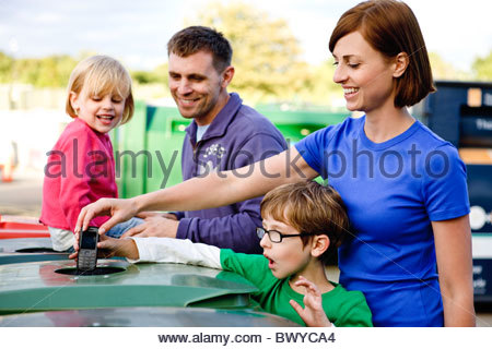 A family recycling a mobile phone - Stock Photo