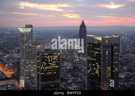 Skyline of financial district and Trade Fair Tower, Frankfurt, Germany - Stock Photo
