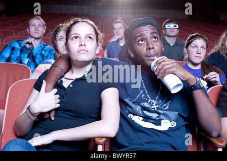 Friends watching movie in theater - Stock Photo