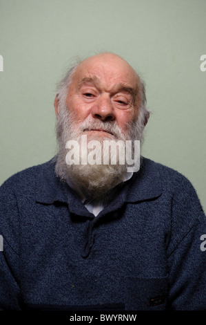 Isolated portrait of caucasian bald old man with long white beard - Stock Photo