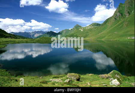 alpine Alps mountains mountain lake Cadagno di Fuori canton Ticino Lago di Cadagno scenery Pizzo Stabbiello - Stock Photo