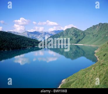 alpine Alps mountains mountain lake canton Ticino Lago Ritom scenery Piatto Pizzo di Sassello Switzerland - Stock Photo
