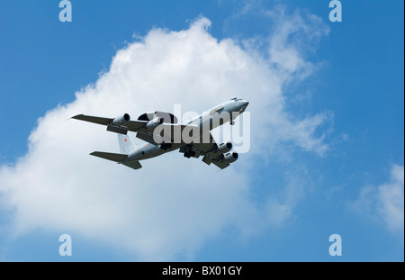 AWACS Boeing E-3F  French Air Force Armee de L'air flying overhead from left to right with blue sky background and - Stock Photo