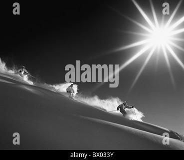 mountains Carving ski group monochrome snow black and white ski skiing sun sport deep snow deep snow dri - Stock Photo